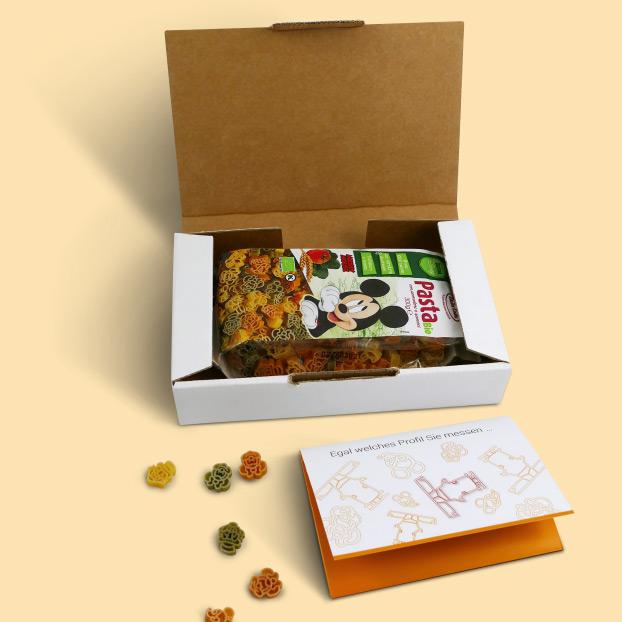 Box von PIXARGUS geöffnet: Micky Maus Pasta und Flyer zum ProfilControl DX ICSM.