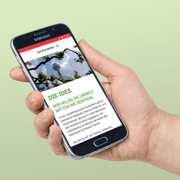 Websiteansicht von Umwelt-ins-Zentrum auf einem Smartphone.