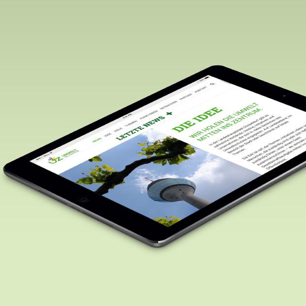 Websiteansicht von Umwelt-ins-Zentrum auf einem Tablet.